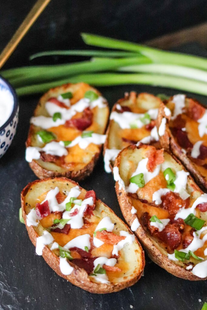 These Air Fryer Potato Skins use cooked potatoes and take less than 10 minutes to make! Serve these on game-day or as a delicious appetizer!