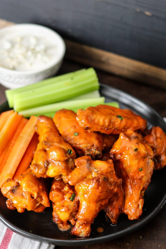 Air Fryer Buffalo Wings are the sauciest and easiest wings ever! Done in less than 20 minutes, you'll never make wings any other way!