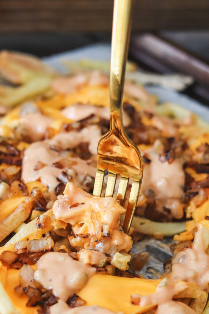 French fries loaded with sweet onions, melted cheese, and zesty sauce make these delicious Copycat In-N-Out Animal Style Fries! Now you can make these anytime at home with this easy recipe!