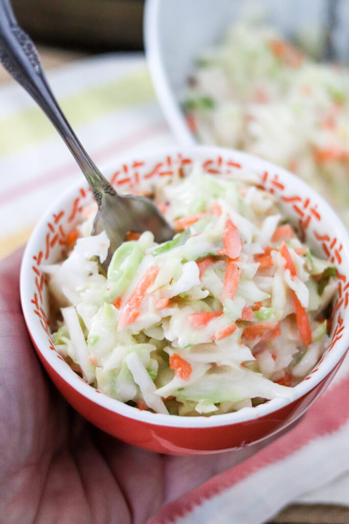 A southern favorite, Chick-fil-A had cool creamy coleslaw on their menu for nearly 50 years, and now you can make the exact recipe at home! This is the BEST COLESLAW!!!