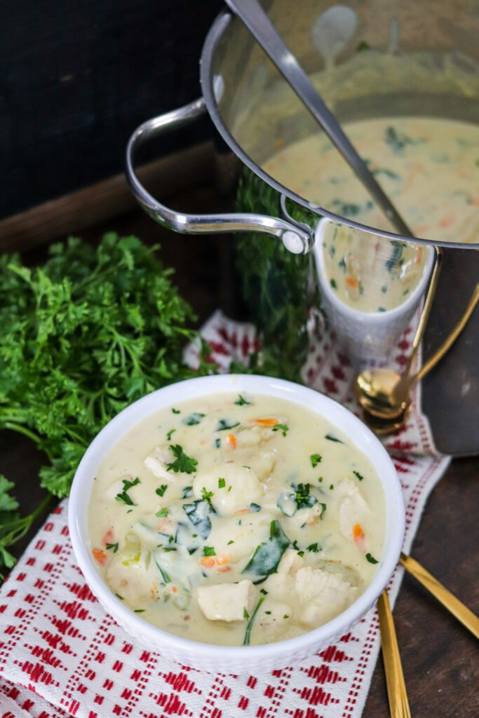 This Creamy Chicken Gnocchi Soup is a family favorite recipe that is delicious and comforting. It's easy to make and filled with tasty vegetables and gnocchi!