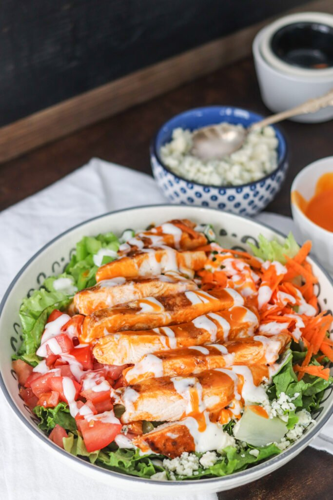 This easy Buffalo Chicken Salad is done in less than 15 minutes and so delicious! Full of fresh ingredients, spicy buffalo sauce, and creamy ranch, this will be a favorite lunch or dinner recipe!