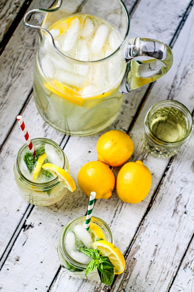 Fresh basil combined with juicy summer lemons make the most mouthwatering Basil Lemonade! It is perfect plain, or with some added alcohol!