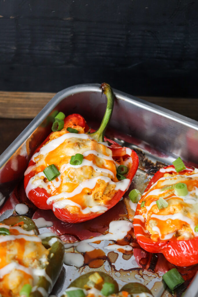 These low carb Buffalo Chicken Stuffed Peppers can be made in the air fryer or oven! This delicious and easy meal is the perfect healthy dinner!
